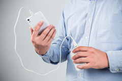 Man is charging smartphone Stock Photography