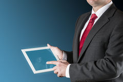 Man with chart on tablet Stock Image