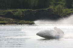A man chase on high-speed on the jet ski. Stock Photos