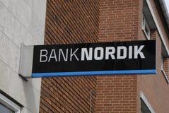 MAN CHASHES AT BANKNORDIK ATM Royalty Free Stock Image