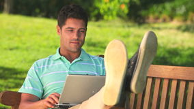Man chatting on a laptop outdoors Royalty Free Stock Photography