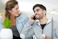 Man chatting on phone on sofa at home. Man chatting on phone on the sofa at home royalty free stock image
