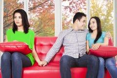 Man cheating his girlfriend Stock Photos