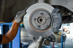 Man check the car brake. Mechanic check the car brake royalty free stock photography