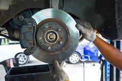 Man check the car brake. Mechanic check the car brake royalty free stock photos