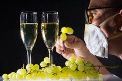 Man check white wine glasses and fresh grape Stock Image