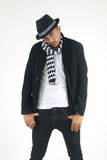 Man in checkered scarf and top hat staring at a subject. Mixed race male standing up who is wearing a checkered scarf and top hat staring at a subject Stock Photography
