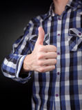 Man in checkered shirt with thumbs up sign Royalty Free Stock Photo
