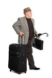 Man in a checkered suit and luggage. Looks away Stock Image