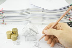Man checking balance sheet with pencil Royalty Free Stock Image