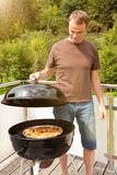 Man checking the bbq chops Royalty Free Stock Image