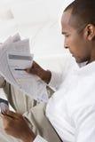 Man Checking Bills Royalty Free Stock Photos