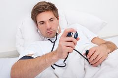 Man Checking Blood Pressure Stock Photography