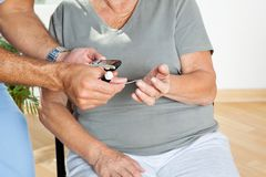 Man Checking Blood Sugar Level Of Patient Stock Images