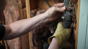 Man checking broken water pipe stock video footage
