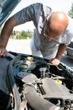 Man checking a car Royalty Free Stock Photography