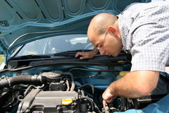 Man checking car engine Royalty Free Stock Photos