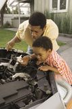 Man Checking Car Engine Oil Stock Photo