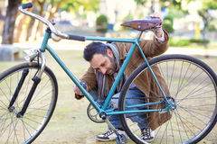 Man checking the chain an bicycle Royalty Free Stock Photography