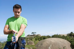 Free Man Checking Climbing Harness - Horizontal Stock Image - 5235421