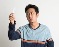 Man checking on a comb with shock face Royalty Free Stock Photos