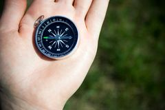 Man checking compass for right direction Royalty Free Stock Photo