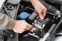 Man checking the engine of his car Stock Image
