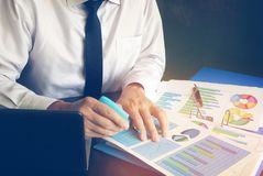 Auditing financial report or creating marketing strategy. Royalty Free Stock Photo