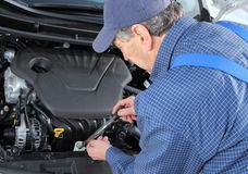 Man checking Frost protection of  coolant in car Royalty Free Stock Images