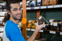 Man checking grocery items in supermarket Royalty Free Stock Photos