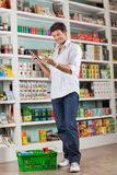Man Checking Grocery List In Supermarket Royalty Free Stock Images