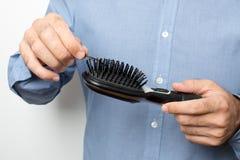 Man checking hair Royalty Free Stock Image