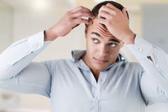 Man Checking Hairline Stock Image