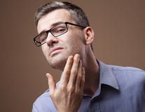 Man checking his beard and skin Stock Image