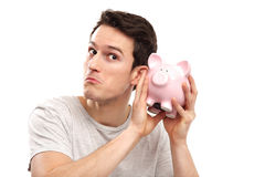 Man checking his piggy bank Stock Photo