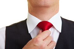 Man checking his tie knot Royalty Free Stock Photo