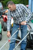 Man checking yard with lawn mower royalty free stock photos