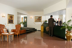 Man checking in at the hotel reception Royalty Free Stock Image