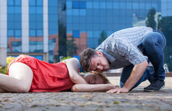 Man checking if woman's breathing Stock Photo