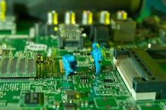Man checking integrated circuits. The concept technology Stock Photos