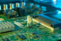 Man checking integrated circuits. The concept technology Stock Photo