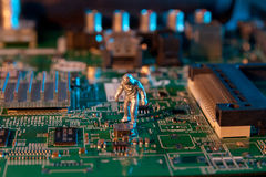 Man checking integrated circuits. The concept technology.  Royalty Free Stock Images