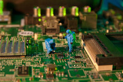 Man checking integrated circuits. The concept technology Stock Image