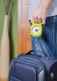 Man checking luggage weight with steelyard balance Royalty Free Stock Photos
