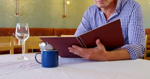Man checking out the menu 4k. Man checking out the menu at restaurant 4k stock footage