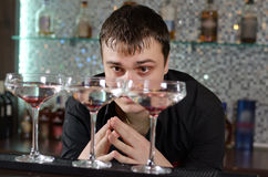 Man checking out three glasses of cocktail Stock Image
