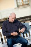 Man checking a photo on his mobile phone Royalty Free Stock Photo