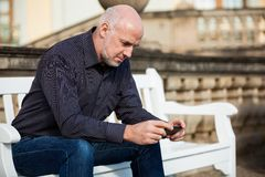 Man checking a photo on his mobile phone Royalty Free Stock Image