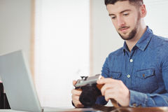 Man checking photographs in camera Stock Photo