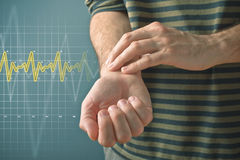 Man checking pulse with fingers Royalty Free Stock Photos